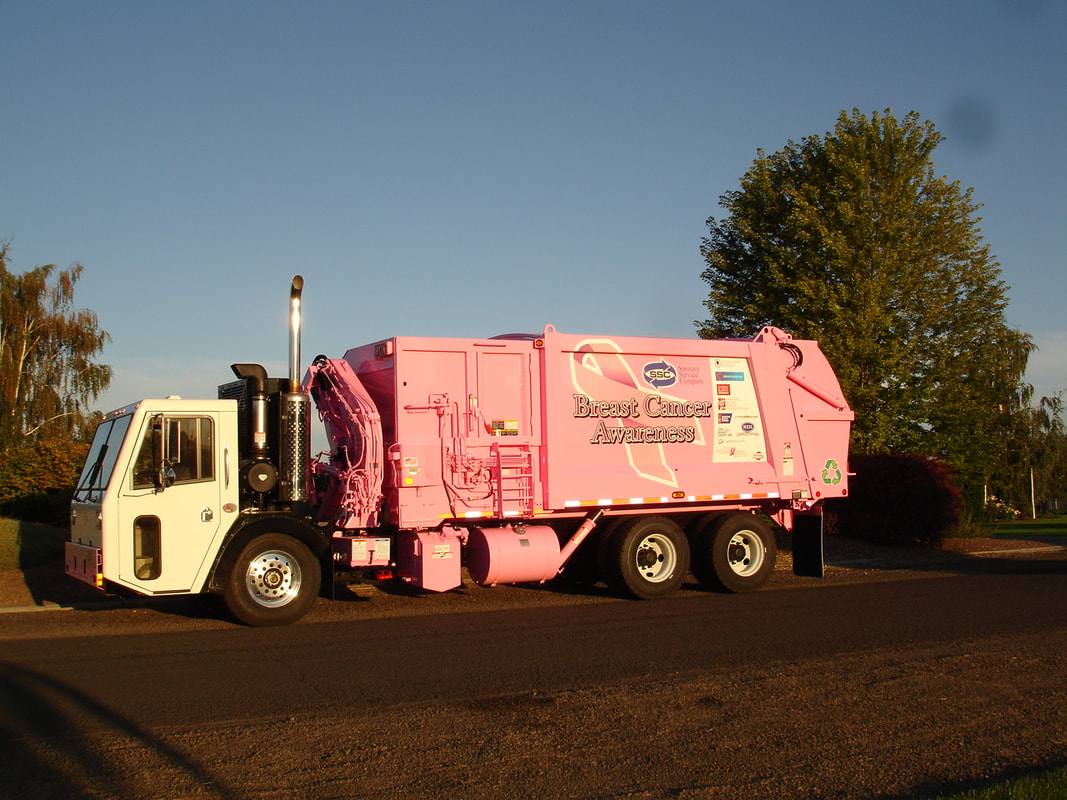 Breast Cancer Awareness Poster on a Pink Garbage Truck